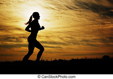 løber, solnedgang